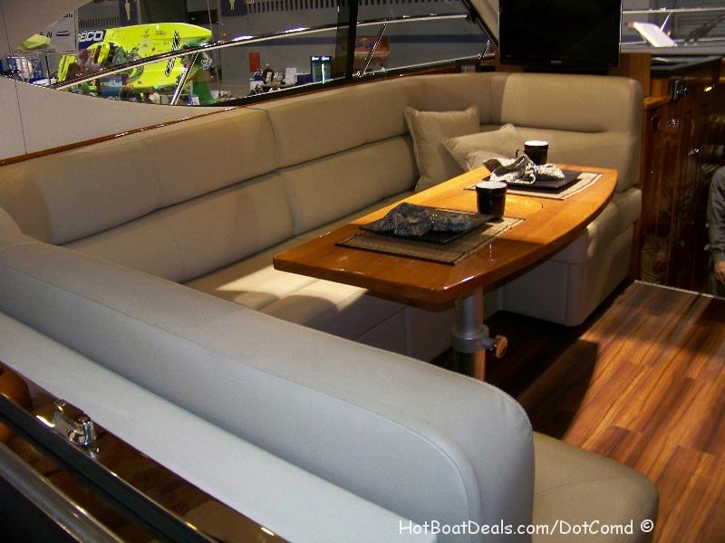 Riviera 4400 Sport yacht Salon Table / Couch <p>How do people get around the big table one at a time?</p>
